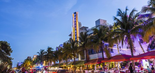 MIAMI USA - AUG 19 2014: people enjoy Night view at Ocean drive in Miami USA. Art Deco Night-Life in South Beach at ocean drive is one of the main tourist attractions in Miami.
